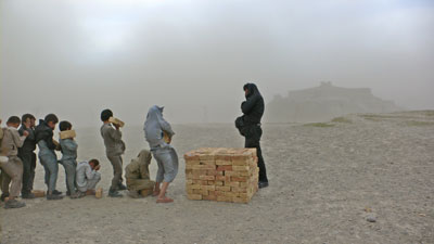 """Brick Sellers of Kabul (2006) by Lida Abdul"
